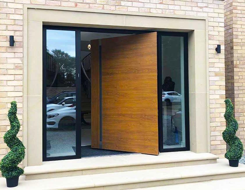 Wood effect aluminium pivot door