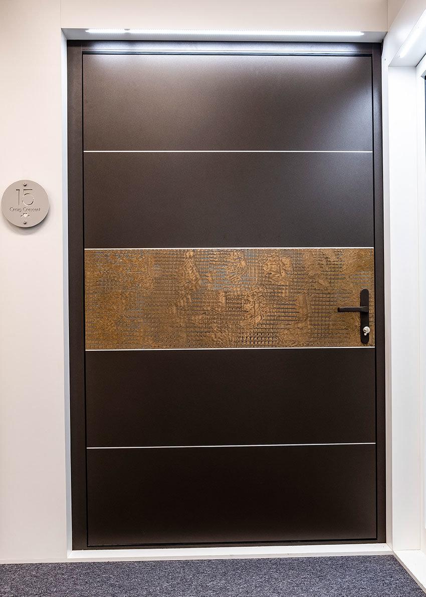Bronze metallic insert pivot door