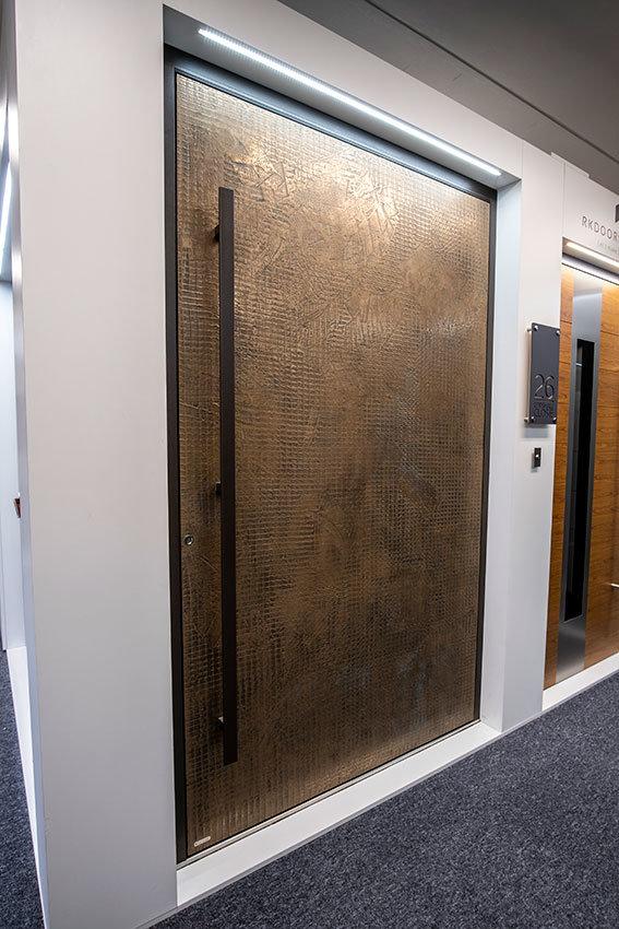 Metallic pivot front door