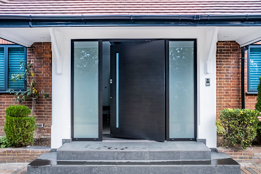 pivot door from- RK Doors with glass sidelights