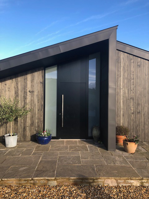RK aluminium door with angled panel above