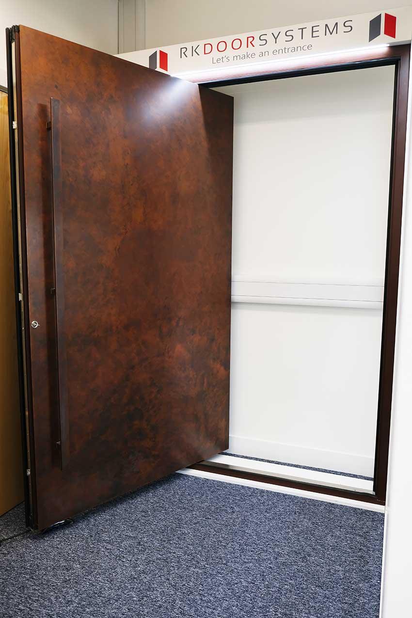 RK Pivot door antique copper finish