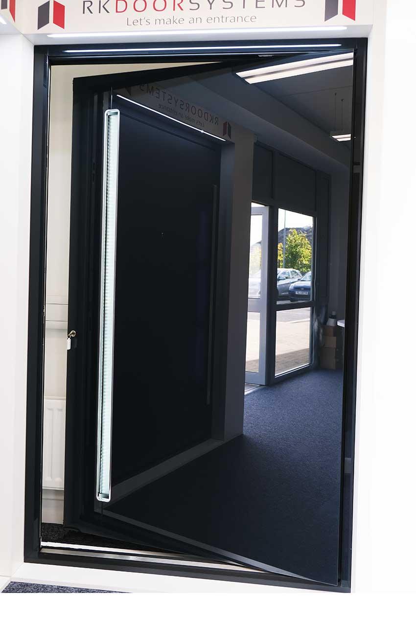 RK glass faced black Pivot door